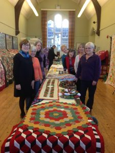Organiser Pat Baker, front left, and fellow quilters at their first exhibition in The Old School Rooms